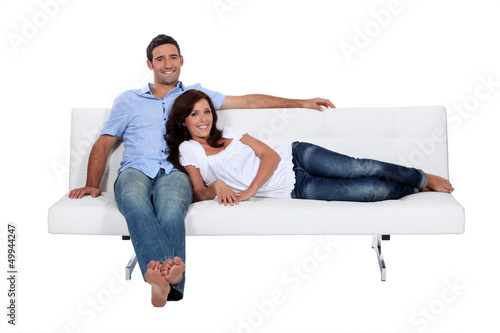 Couple on couch comfortably installed
