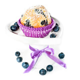 Blueberry cupcake on a decorated plate isolated on white