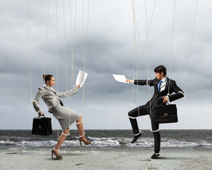 Puppet businesspeople