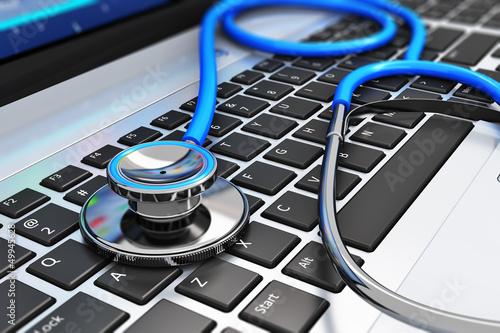 Leinwandbild Motiv Stethoscope on laptop keyboard