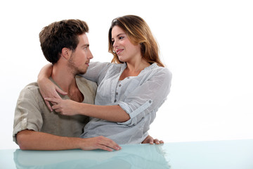 Woman sitting in the lap of her boyfriend