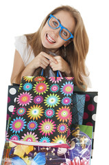 Crazy funny young girl with shopping gift bags, wearing glasses.