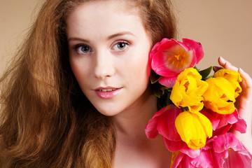 Beautiful redheaded girl with tulips