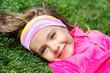 Preschool girl on green grass