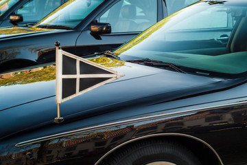 Official flag on a Dutch funeral car