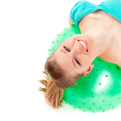 Young happy woman with fit ball, isolated over white background