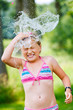 girl having fun outdoor with water