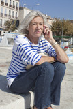 mature woman dealing with issues on the phone poster