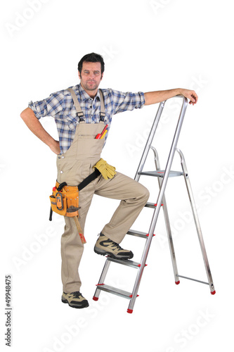 Laborer leaning on a ladder isolated on white background