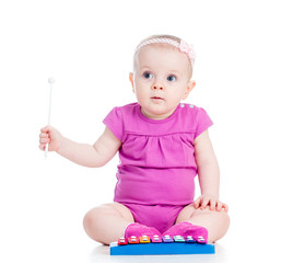 girl baby playing musical toy