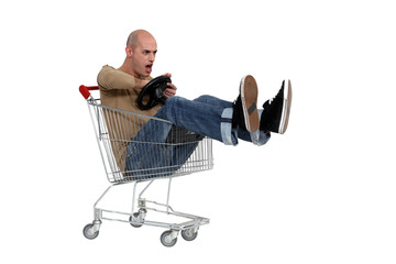 Man driving a shopping trolley