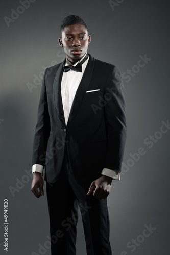 Cool stylish black american man in gala suit. Fashion shot.