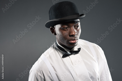 Vintage black american man in suit with hat. Fashion studio shot