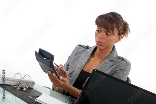 Businesswoman with a calculator