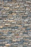 Ancient wall from slim granite brick.