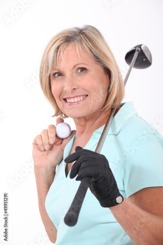 Mature female golfer