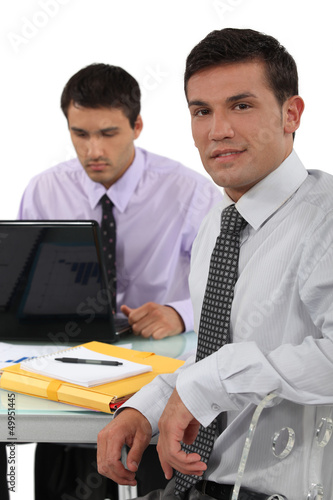 Two business colleagues sat at desk
