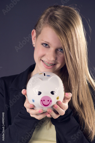 Blond smiling Teenie saving her Money