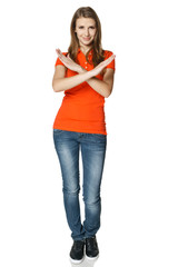 Smiling young woman in full length making stop gesture