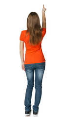 Back view of  female in full length pointing at blank copy space