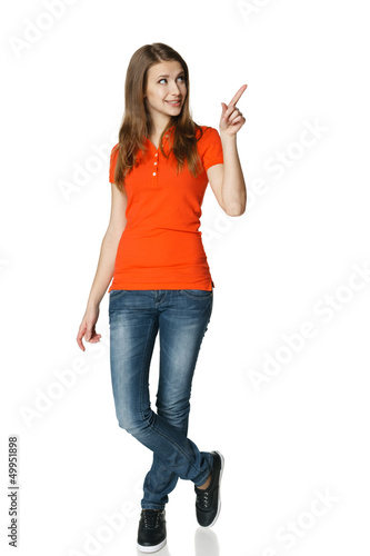 Full length of young woman pointing to the side