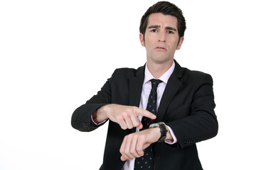 Businessman pointing at his watch