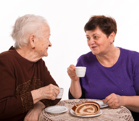 Mother having coffee with her daughter