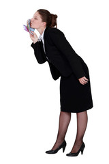Businesswoman kissing money