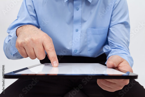 Man working on tablet - closeup on device and hands