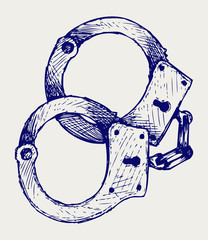 Metallic handcuffs. Doodle style
