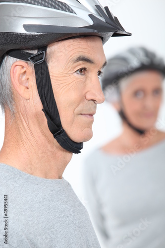 Elderly couple with cycle helmets