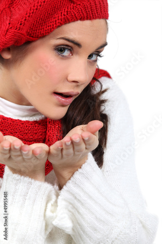 woman blowing kisses in air
