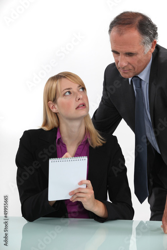 Woman silently communicating with her boss
