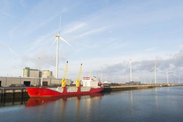 red cargo boat in harbor