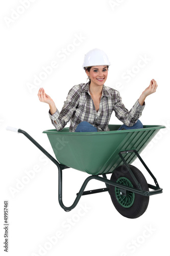 Female construction worker doing yoga