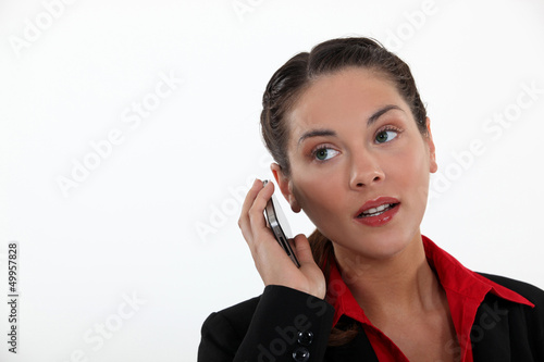 woman with cell phone straining her ears