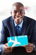 handsome african businessman holding air ticket