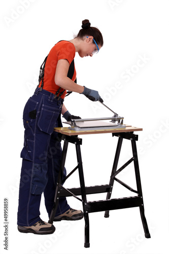 Woman cutting tile