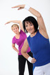 two senior women doing fitness