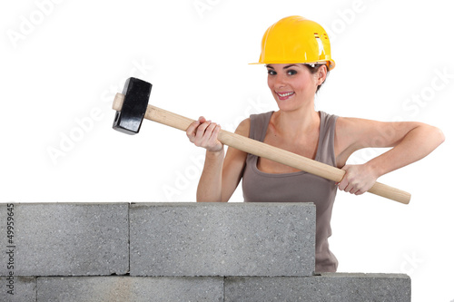 Woman with a  sledge hammer