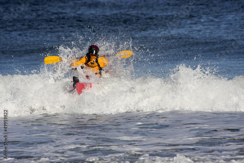 Kayaker on the crest of a wave