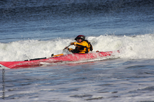 Kayaker in action on rough sea