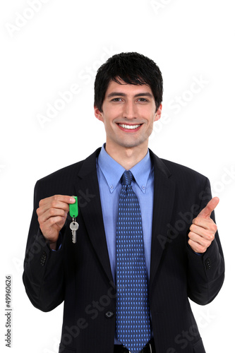 Car salesmen holding keys