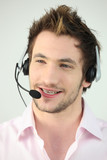 Attractive man speaking into a headset