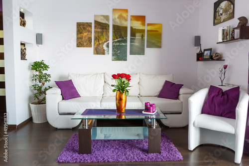 Modern lliving room interior with canvas on the wall