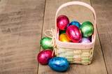 Wicker Easter basket with foil chocolate eggs