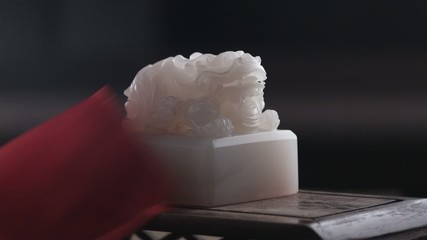removing silk to expose jade seal