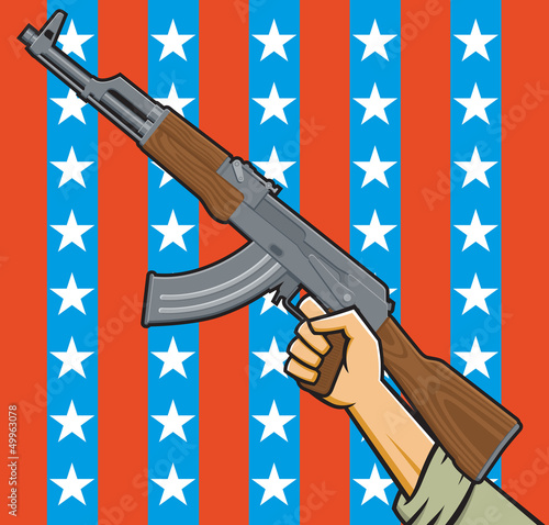 Assault rifle in front of American stars and stripes.