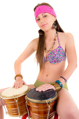 beautiful woman playing bongos studio shot