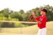 Little league baseball player catching the ball.